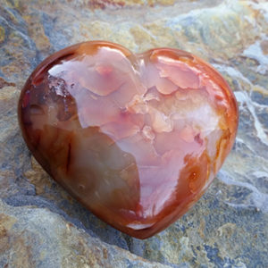 Beautiful, richly colored Carnelian Heart shaped stone. 3.5″ in diameter. Sherrie Wirth Intuitive Psychic Shop