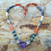 Lovely gemstone necklace. Gems include carnelian, lapis, turquoise and an amethyst centerpiece. Sherrie Wirth Intuitive Psychic Shop